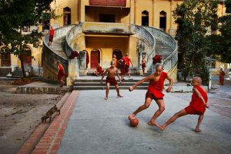 Burma/Myanmar, 2010. Group of young monks playing soccer.